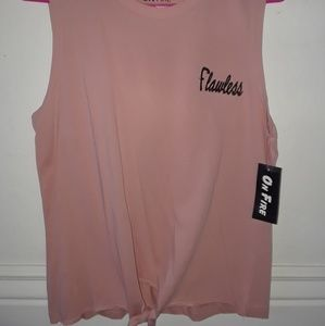 """Sleeveless pink shirt that says """"flawless"""""""